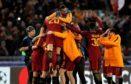 Roma's players celebrate.