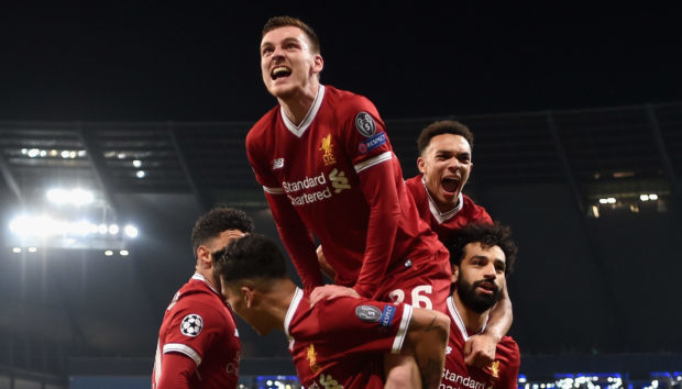 Andy Robertson celebrates with his Liverpool teammates.