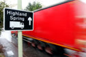 A lorry passing a sign for Highland Spring in Blackford.