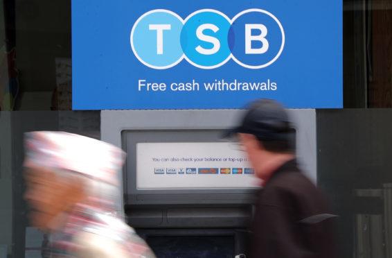A man uses a TSB cash machine