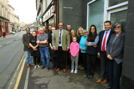 Courier News - Jim Millar story - Parking Concerns. CR0000628 Picture shows; Cllr Gavin Nicol, centre of group, with representatives from local businesses in St. David Street, in Brechin today. Monday 16th April 2018.