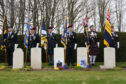 Courier News. Angus story CR0000646 ANZAC ceremony at graveside of four New Zealand airmen in Arbroath's Western cemetery. One of Scotland's biggest ANZAC commemorations, will include senior figures from organisations including the NZ High Commission. Pic shows; Standard bearers during the ceremony. Sunday, 22nd April, 2018.