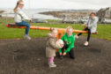 Youngsters Eva Goodman, Melissa McIntyre, May Goodman and Jessica Keyte will be able to keep playing at the park on Manse Road, Inverkeithing.