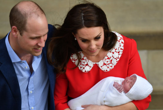 The Duke and Duchess of Cambridge and their newborn son