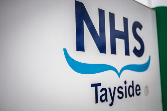 The Lib Dems have warned against merging health boards in the wake of the NHS Tayside financial crisis.