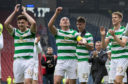 The Celtic players celebrate after cup win.