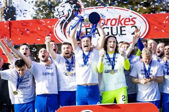 Montrose celebrate winning the Ladbrokes League Two title