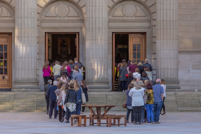 Fans queuing outside the Caird Hall.