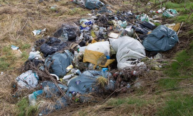 There is a warning that fly-tipping near railway lines is not just bad for the environment — it could case a serious accident. (library photo)