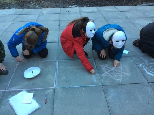 Pupils from St Ninian's getting involved in artwork in Guard Vennel in Perth city centre