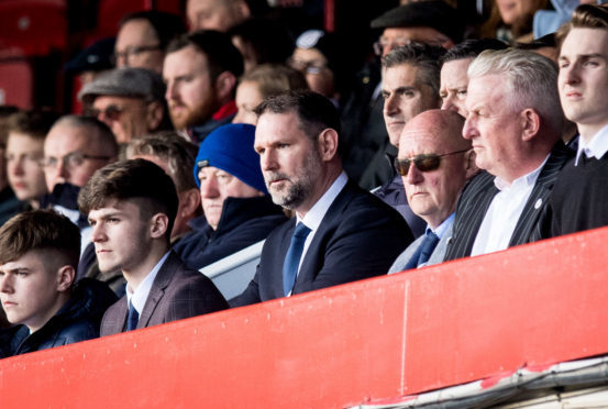 Dundee managing director John Nelms (centre) says it is costing £300,000 a year to keep Dens Park operational.