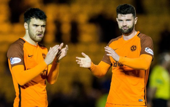 Scott Fraser and Mark Durnan applaud the United fans at full-time at Livingston.