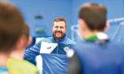 Former professional footballer  Russell Taylor of Futsal Escocia  coaching children at Inverkeithing High School in Fife.