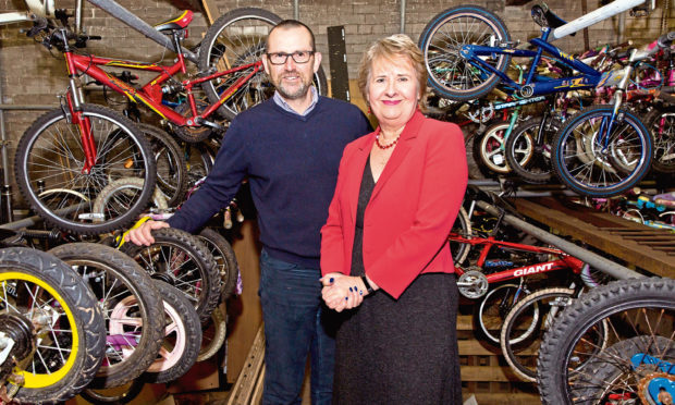 Iain Gulland of Zero Waste Scotland with Scottish Environment Secretary  Roseanna Cunningham on a visit to The Bike Station of Perth, an  organisation ...