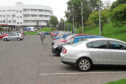 A correspondent says Angus councillor Colin Brown should not be considering charging staff to park, as is the case at Ninewells Hospital.