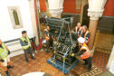 The old linotype machine being moved into the McManus.