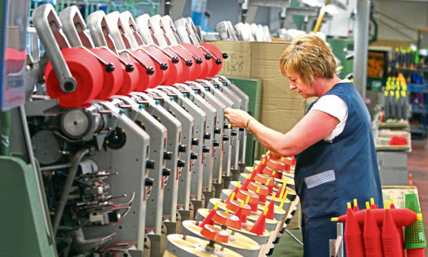 A technician oversees the yarn spinning process at Todd & Duncans Lochleven Mills at Kinross.