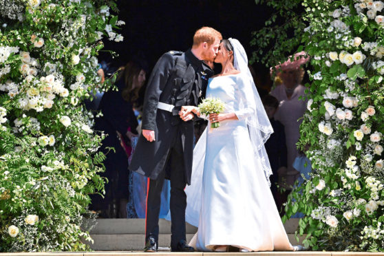 Prince Harry and Meghan Markle kiss as they leave at St. George's Chapel in Windsor Castle after their wedding.