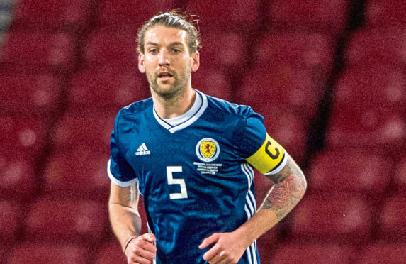 Charlie Mulgrew in action for Scotland.