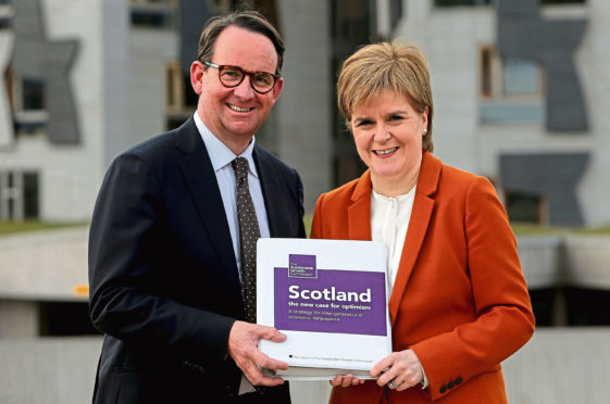 First Minister Nicola Sturgeon receives the Sustainable Growth Commission report from commission chair Andrew Wilson.