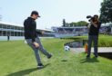 """Rory McIlroy takes part in a football golf challenge during the BMW PGA Championship Pro Am yesterday """"the first time I've kicked a ball since (my five a sides injury) in 2015"""" he joked."""