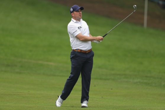 Richie Ramsay hits his second shot on the 4th during the first round of the BMW PGA Championship.