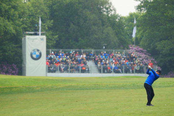 Rory McIlroy stayed in the lead at the BMW PGA Championship at Wentworth, but only just.