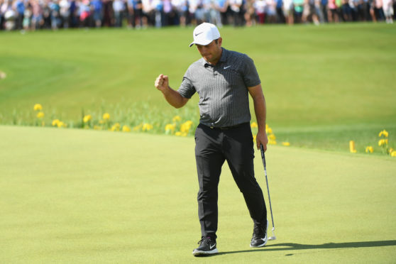Francesco Molinari clinches victory on the 18th at Wentworth.