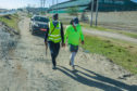 Mark walking with an armed guard during the marathon trek