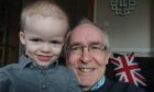 Ezekial King and his grandfather Jon Harle, who is cycling to Dundee