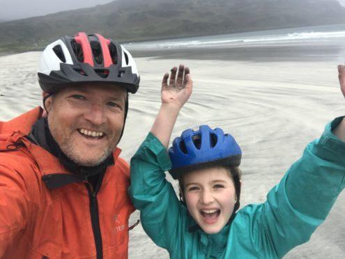 Robin and daughter Tara at Laig Bay on Eigg.