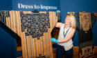 Rhona Rodger (Senior Officer, Collection Management, Culture Perth and Kinross) alongside two Japanese Ainu robes (woven elm tree bark).