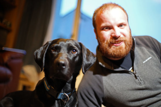 Ian Killoh reunited with his dog, Diesel.
