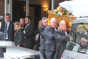 Pallbearers carry the coffin of Liam Colgan.