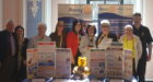 Members pictured at their stand at the District 1010 Assembly 2018 after being presented with the award. L-R Ken Caldwell, Anne Marie Caldwell, Amy Mathewson, Alana Brown, Christie Robb, Claire Robb, Christine McIntosh, Peter Ramsay Smart and Alistair Robb.