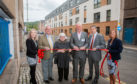 Left to right: Stephanie Joss (corporate administrator, Fairfield), Councillor Bob Brawin, Rena Crighton (chairperson, Fairfield), Grant Ager (chief executive, Fairfield), Stewart Shearer (managing director, Robertson Partnership Homes) and Sharon Bell (corporate manager, Fairfield), at the official opening of the development.