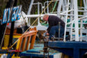 Picture shows maintenance work on some of the boats in Pittenweem Harbour.