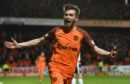 Sam Stanton celebrates scoring the winner for United.