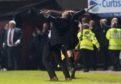 Csaba Laszlo celebrates at the final whistle.