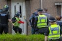 A drugs raid at a house in Cramond Gardens, Kirkcaldy.