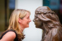 Dr Nicola Cowmeadow alongside the Fair Maid statue.