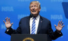 President Donald Trump speaks at the National Rifle Association annual convention in Dallas.