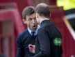 Neil McCann argues with fourth official Willie Collum at Fir Park.