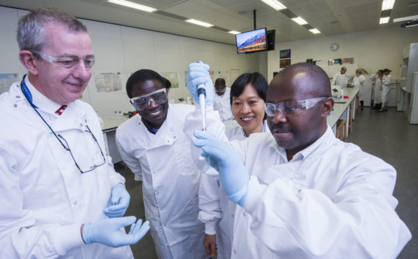 Dr Sabiiti, right, demonstrates the test to Frank Bonsu from Chana and Thuong Nguyen from Vietnam, while Professor Gillespie, left, looks on
