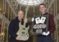 Midge Ure with Stephen Allen, curator at the National Museum of Scotland