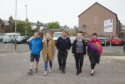 Jim Stewart, Laura Walton, Barrie Ewart, Nicola Ewart and Councillor Julie Bell in the Glengate Car Park, Kirriemuir.