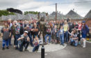 AC/DC fans at the Bon Scott statue in Kirrie.