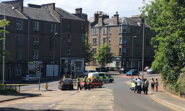 Emergenxy services at the scene of the incident at Dudhope Terrace's junction with Lochee Road