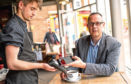 Colin Munro, managing director of Miconex, receives some loyalty points with his coffee.