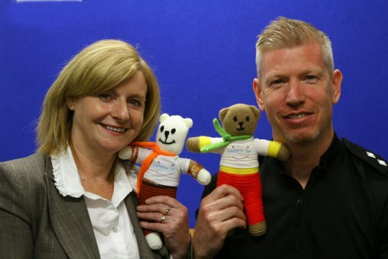 Linda Jardine of Children 1st and Insp Chris Boath at the launch of the Trauma Teddies.